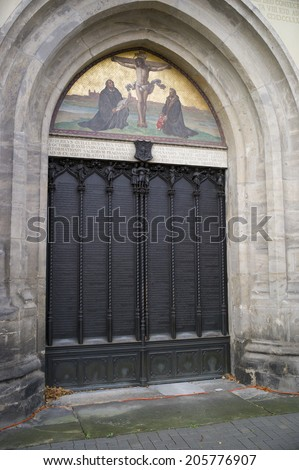 Wittenberg, Germany - Nov 4: the All saint's church where Martin Luther nailed the ninety-five theses on the door and sparked the reformation in Wittenberg, Germany on November 4 2013. - stock photo