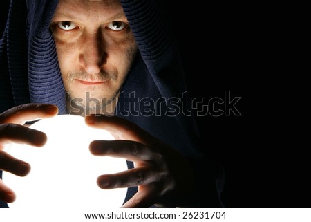 Wizard with glowing magical orb close-up - stock photo