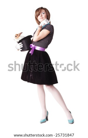Wizard young female holding hat with magic rabbit inside - stock photo