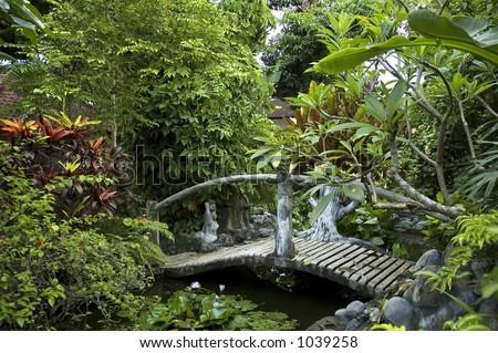 woden bridge in eastern garden - stock photo