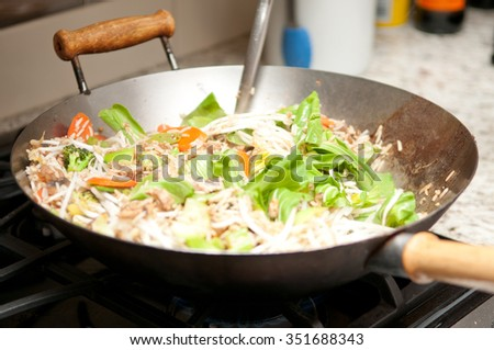 wok fried chicken stir fry with rice and chinese vegetables - stock photo