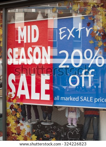 Wokingham, Market Place, Berkshire, England - October 3, 2015: M and Co ladies, men and children fashion store window display advertising mid season sale - stock photo