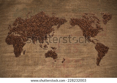 wold map made of coffee beans on textured background /with clipping path - stock photo