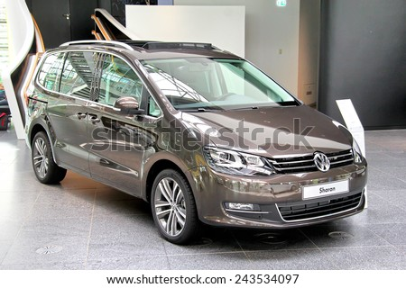 WOLFSBURG, GERMANY - AUGUST 14, 2014: Brand new 7-seat MPV Volkswagen Sharan in the trade center of the Volkswagen Autostadt. - stock photo