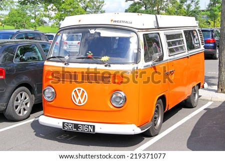 WOLFSBURG, GERMANY - AUGUST 14, 2014: German classic van Volkswagen Transporter at the city street. - stock photo