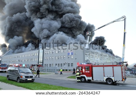 WOLKA KOSOWSKA, POLAND - MAY 10: Firefighters extinguish a raging fire in a China Mart storehouse, May 10, 2011 in Wolka Kosowska, Poland. The fire burned 150 storage units covering nearly 2 hectares - stock photo