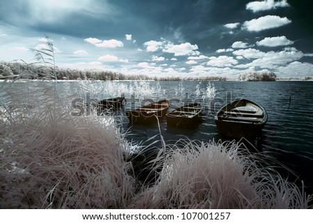 Wolsztyn Lake and boats in Greater Poland, Poland. The infrared image - stock photo