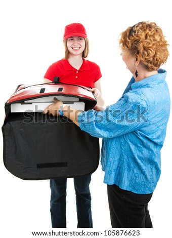 Woman accepting pizza from a young delivery girl.  Isolated on white. - stock photo
