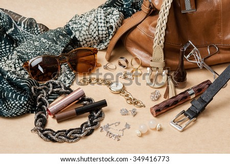 woman accessories on brown background - stock photo