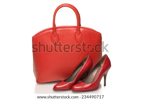 Woman accessories on white background, red handbag and  high heels - stock photo