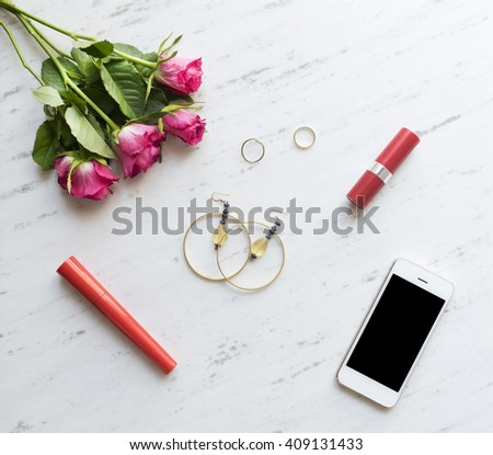 Woman accessories on white marble, top view - stock photo