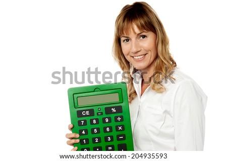 Woman accountant holding big green calculator - stock photo