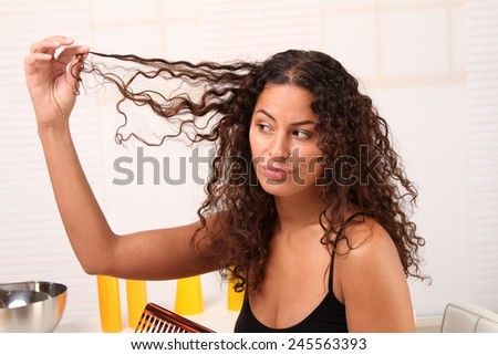 Woman admiring her long hair - stock photo