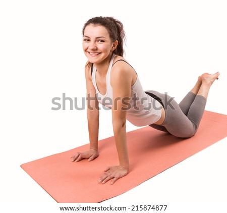 woman aerobics mat isolated on white background - stock photo