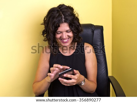 Woman amused by what she is seeing on the internet - stock photo