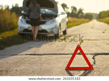 woman and a broken car - stock photo