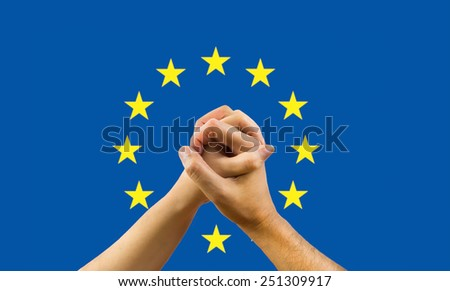 woman and a man in his hands with a flag of europe background in concept of unity - stock photo