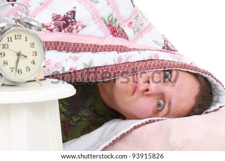 Woman and alarm clock - stock photo