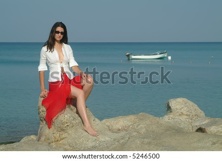 Woman and boat, Neos Marmaras, Greece - stock photo