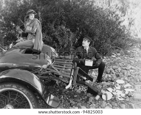 Woman and chauffer after car accident in country - stock photo