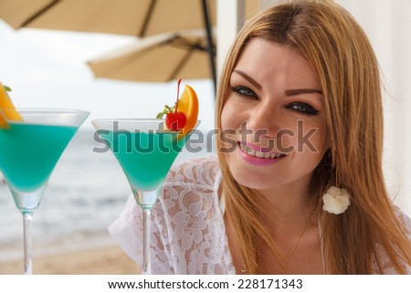 Woman And Cocktail On The Beach With Sea View - stock photo