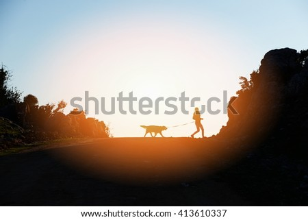 Woman and dog walking - stock photo