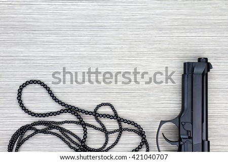 Woman and gun, Pistol and black necklace, Woman necklace with gun, Gun and accessories, Handgun and accessories. - stock photo