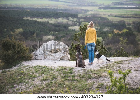Woman and her dogs posing outdoor.  - stock photo