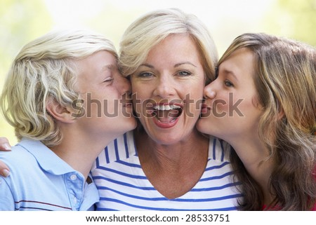 Woman And Her Teenage Children - stock photo