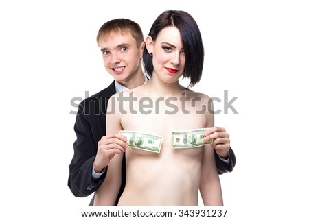 Woman and man cover her breast with dollars. Isolated photo of people with white background. - stock photo