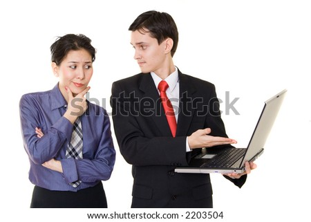 Woman and man discussing some info from laptop - stock photo