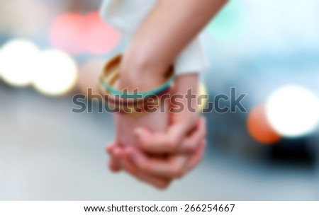 woman and man hand holding together , blurred for presentation , abstract background - stock photo