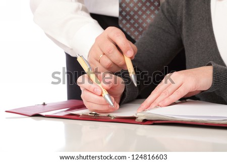 woman and man in grey write by pen on paper. Businesswoman signs. Isolated on white background - stock photo