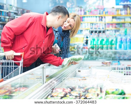 Woman and man in market - stock photo