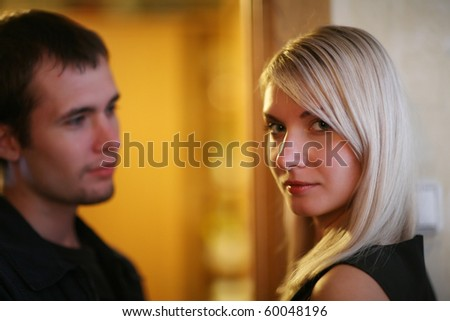 Woman and man in relationship. Shallow DOF. - stock photo