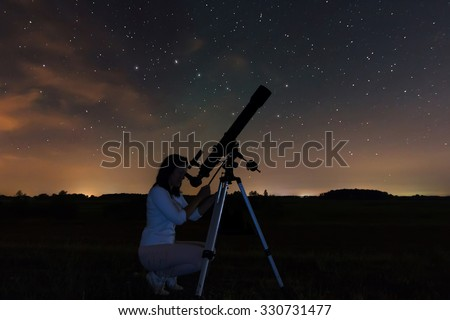 Woman and night sky. Watching the stars Woman under Night sky, constellations, Draco, Ursa Major, Big Dipper, Botes.  - stock photo