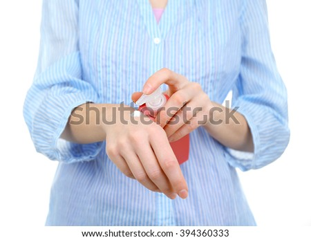 Woman applying hand cream, isolated on white - stock photo