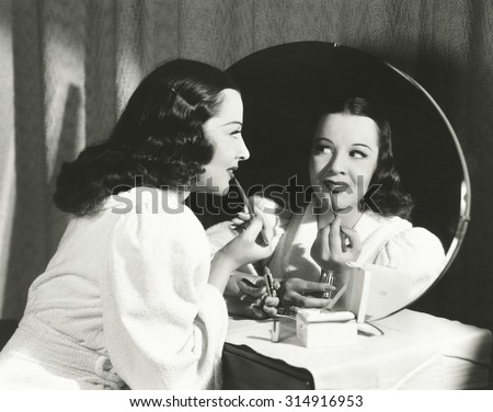 Woman applying lip liner - stock photo