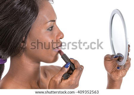 woman applying lipstick - stock photo