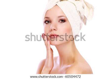 Woman applying moisturizer cream on face - stock photo