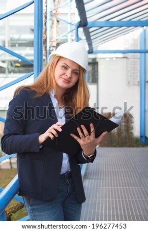 Woman architect with folder - stock photo