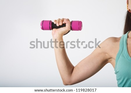 woman arm at gym lifting dumbbells over white background - stock photo