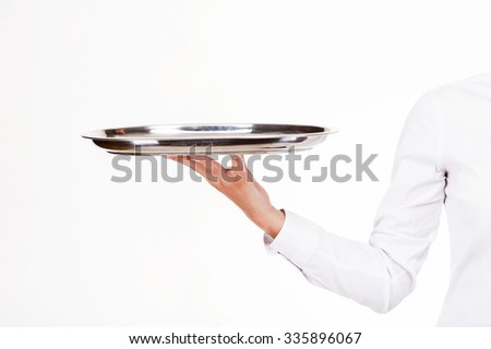 Woman arm in waiter uniform holding tray. Over white background. - stock photo