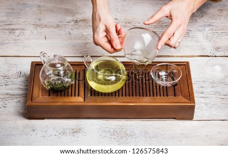 Woman arranging chinese tea ceremony - stock photo