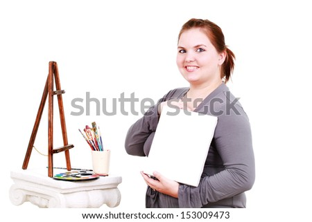 Woman artist with a canvas - stock photo