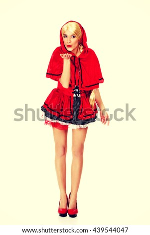 Woman as a Little Red Riding Hood. - stock photo