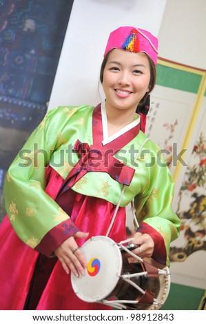 Woman asian drum hanbok dress korea - stock photo
