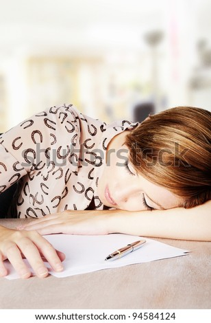 woman asleep at her desk in work time - stock photo