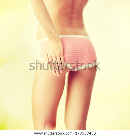 Woman ass with hand on - stock photo