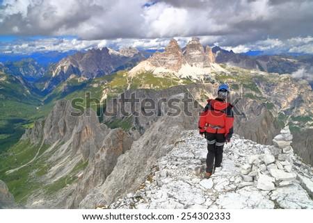 Woman assiving on the summit of Cima Nord Est, Cadini di Misurina, Dolomite Alps, Italy - stock photo